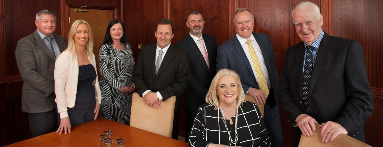 Photograph of staff team in the boardroom at McCarthy Developments