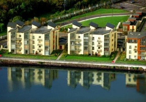 Photograph of aerial view with water reflections at Hartys Quay Apartments