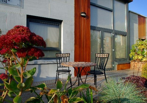Photograph of patio with table and chairs at Hartys Quay Apartments
