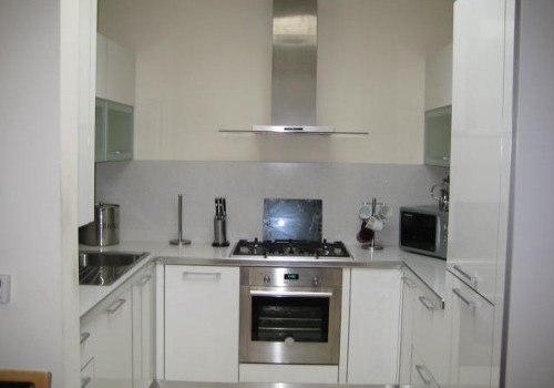 Photograph of white kitchen at Hartys Quay Apartments