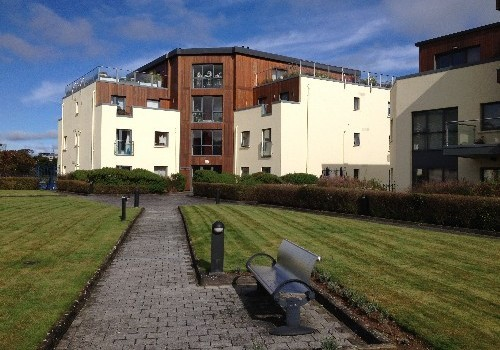 Photograph of lawn and paths leading to Hartys Quay Apartments