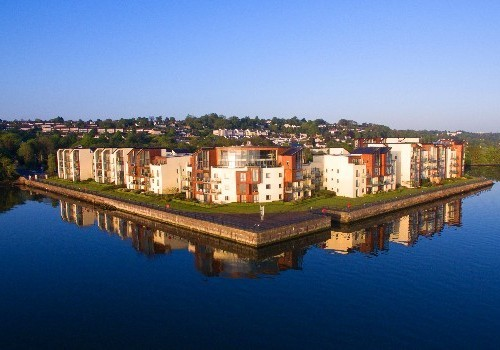 Photograph of apex of quay with still water at Hartys Quay Apartments