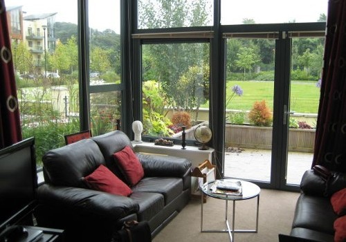 Photograph of sitting room with patio view at Hartys Quay Apartments