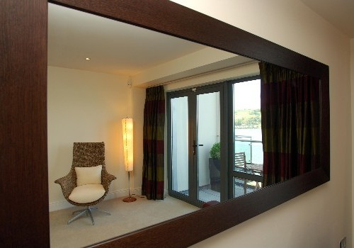 Photograph of living room through mirror at Jacobs Island Apartments