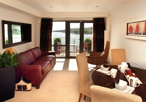 Photograph of living room with sea view at Jacobs Island Apartments