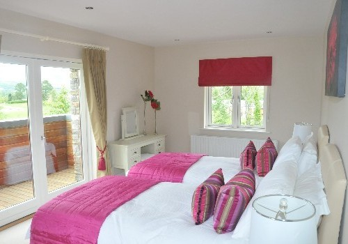 Photograph of Sheen Falls Mountain View bedroom with pink decor