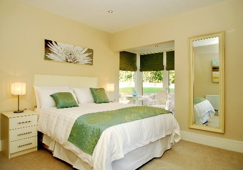 Photograph of Sheen Falls Mountain View green and white decor bedroom