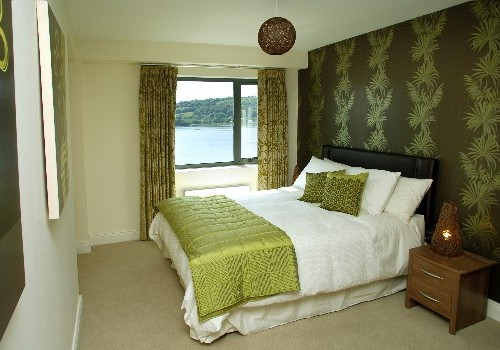 Photograph of bedroom decorated green at Jacobs Island Apartments